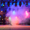 Smoke on an empty stage lit by Blue, Purple, Red, Orange and Green lights