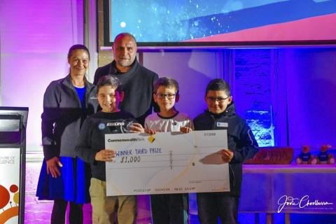Third prize winners holding $1000 cheque for Indigi Hack 2019.