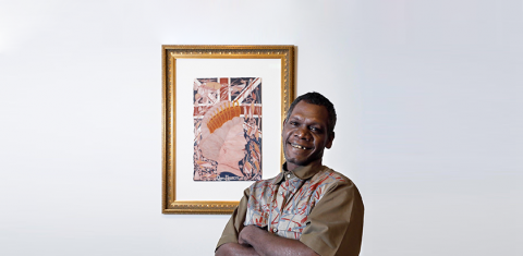 Titus Nganjmirra artist with his artwork titled 'Queen Elizabeth'.